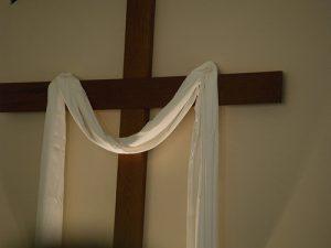 Cross draped in white