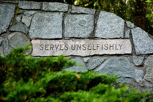 Serves unselfishly, in stone